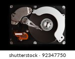 close up of hard disk  isolated on black background High reolution - stock photo