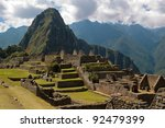 Three Doorway group framing Wayna Picchu in Machu Picchu. - stock photo
