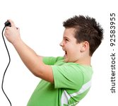 teen boy playing and having fun with video console. Isolated on white. - stock photo
