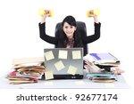 Isolated businesswoman sitting on white background with luggage - stock photo