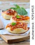 three small mini pizzas on board - stock photo