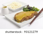 Katsu Kare - Tonkatsu - Japanese breaded deep-fried  pork cutlet served with shredded cabbage and curry sauce - stock photo
