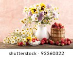 strawberries and bouquet of  flowers - stock photo