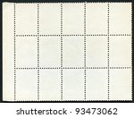 Blank postage stamps block of fifteen framed on a black background - stock photo