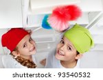 Kids dusting in their room - cleaning up day - stock photo