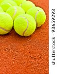 Close-up of tennis balls on a clay court - stock photo