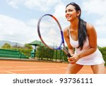 Woman playing tennis and waiting for the service - stock photo