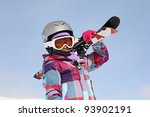 Girl carrying skis - stock photo