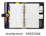 Personal black organizer with pen isolated on white. - stock photo