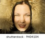The girl in a fur hood - stock photo