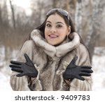 The smiling girl in a fur coat - stock photo