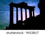 Roman Forum Ruins in Italy.It is photographed against the sun in the evening. - stock photo