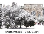 ROME - FEBRUARY 04: Amazing view of the Arch of Constantine with snow on February 4, 2012. Snowfalls in Rome are very rare, the last similar snowfall was in 1985. - stock photo