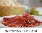 serrano, jamon on the plate and parmesan - stock photo