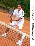 Male tennis player waiting for a service - stock photo