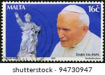 MALTA - CIRCA 2001: A stamp printed in Malta shows John Paul II (1920-2005), statue, series, circa 2001 - stock photo