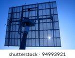Solar Panels Silhouette Against Blue Sky - stock photo