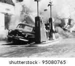 Vehicle exploding at gas station - stock photo