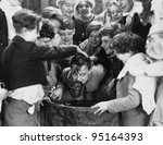 Children crowded around apple bobbing - stock photo