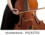 closeup on hand with bow playing the double bass - stock photo