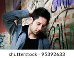 Portrait of pensive man in urban background - stock photo
