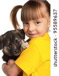 Portrait of little girl with cute puppy isolated on white background - stock photo