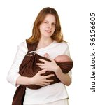 Mother with baby in a sling - stock photo