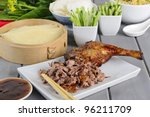 Peking Duck - Chinese roast duck served with pancakes, cucumber, spring onions and hoisin/plum sauce. Side dish of egg fried rice and prawn crackers. - stock photo