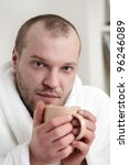 frozen man with tea cup - stock photo