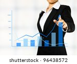 business woman drawing a chart - stock photo