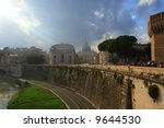 The Vatican as seen from across the Tiber River in Rome Italy. - stock photo