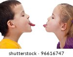 Bad behavior - kids sticking out tongues and mocking each other - stock photo