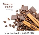 Coffee beans with cinnamon sticks, chocolate over white background with space for your text - stock photo