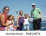 Family on the boat - stock photo