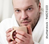 man with tea cup - stock photo