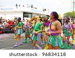 LIMASSOL,CYPRUS-MARCH 6, 2011: Unidentified people in amazonian costumes  during the carnival parade, established in16th century, influenced by Venetian traditions. - stock photo