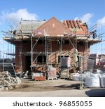 Building & Construction Site in progress to new house in UK - stock photo