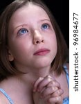 Young girl praying and crying - closeup portrait - stock photo