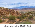 Rock Formations in Arches National Park with La Sal Mountains in the Background. Utah, USA - stock photo