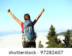 Success. Successful happy hiker cheering having reached summit and goal. Young woman hiking in mountain nature joyful. - stock photo