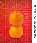 Oranges stacked together in 8 shape (symbolizes good luck) isolated on a texture background. - stock photo