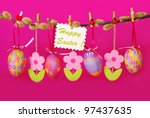 easter border with hanging colorful eggs and  felt flowers against pink background - stock photo