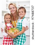 Healthy eating education concept - preparing a fresh salad with the kids - stock photo