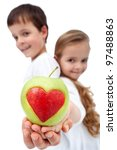 Happy kids holding apple - healthy eating concept - stock photo