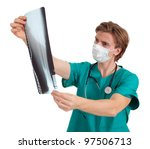 male doctor in medical mask looking at x-ray, leg - stock photo
