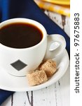 Cup of coffee and two cubes brown sugar. - stock photo