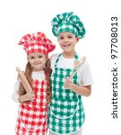 Happy kid chefs with hats and aprons holding cooking utensils - isolated - stock photo