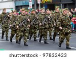 LIMERICK, IRELAND - MARCH 17:  Unidentified soldiers of Irish army participate in a parade for St. Patrick's Day. It's a traditional Irish holiday celebration. March 17, 2012 in Limerick, Ireland. - stock photo