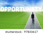 Businessman walks with suitcase on the path reaching the opportunity - stock photo