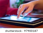 hand finger touching screen on tablet-pc - stock photo